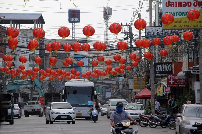 The roads in Naklua market are decorated with Chinese lanterns in preparation for Chinese New Year.