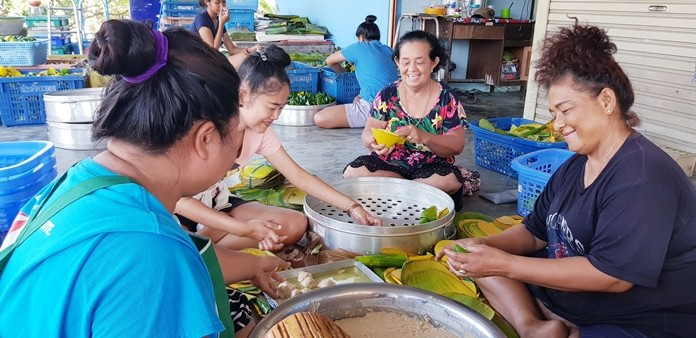 It's a family affair. Aunty Sailom (centre) happily works with her kinfolk.