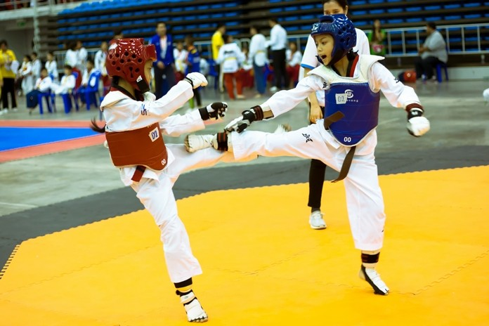 Young martial artists high-kick their way through the qualifying round.