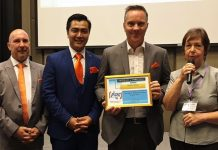 MC Judith Edmonds presents the PCEC's Certificate of Appreciation to Andrew Stocks, joined by his fellow Sunshine Representatives Ittphuman Tanatchok and Torsten Voigt, for his interesting presentation about Sunshine Residences advantages for older Expats.
