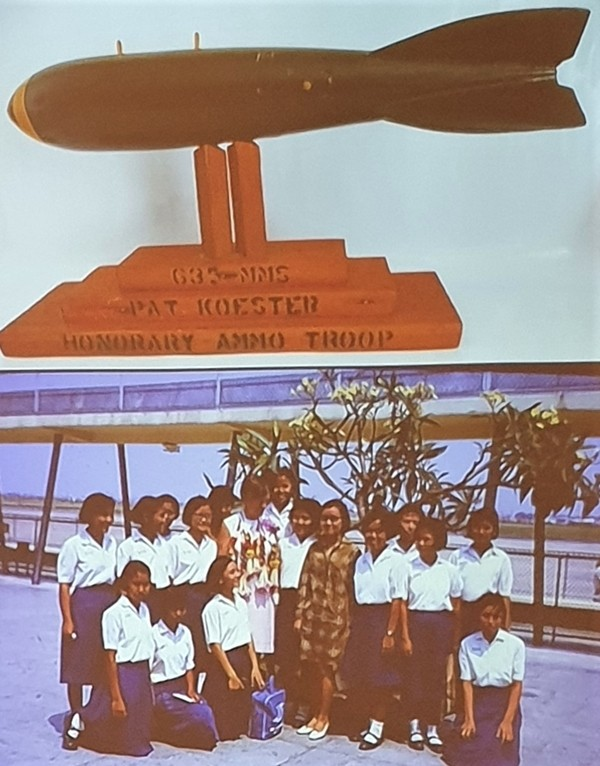 This slide represents some of her mementos Pat Koester said. The top is a bomb replica presented to her by airmen from U-Tapao Airfield that loaded the ordinance on the B-52s and the bottom is some of the children from where she lived during her time as a Peace Corps Volunteer.