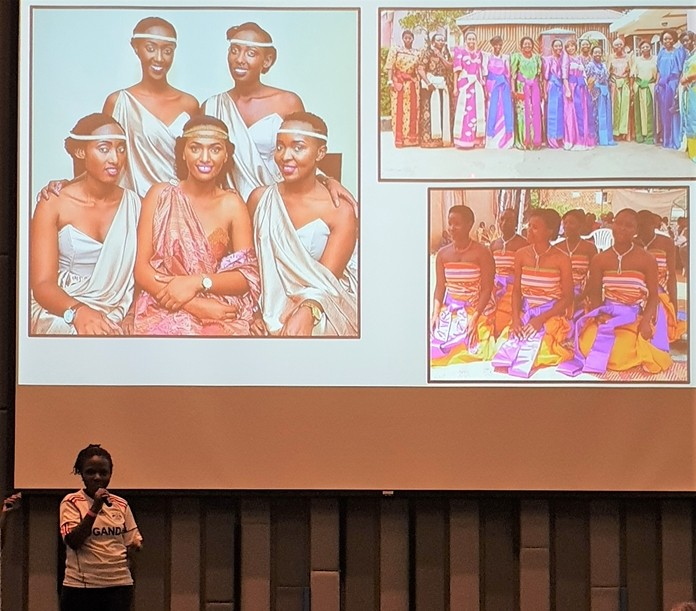 Juliett Nakyonyi shows this photo of Ugandan ladies from different regions of Uganda describing the differing styles of dress.