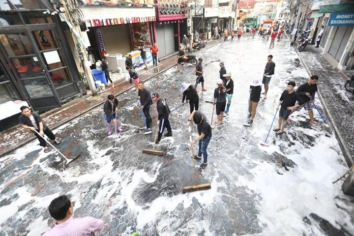 Deputy Mayor Manote Nongyai and nightlife strip businesses sweep, wash and scrub down Walking Street.