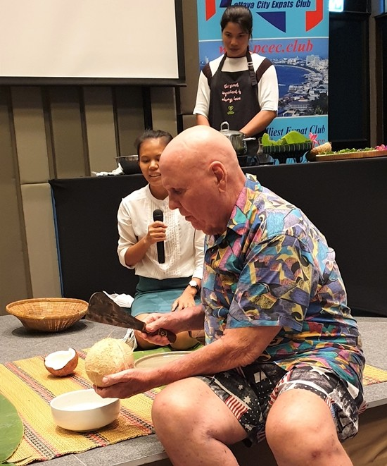 Is this how you do it? PCEC Member Ron Dittmer prepares to cut open a coconut according to Sasi's instructions. He succeeded without cutting off any fingers to the delight (disappointment?) of the audience.
