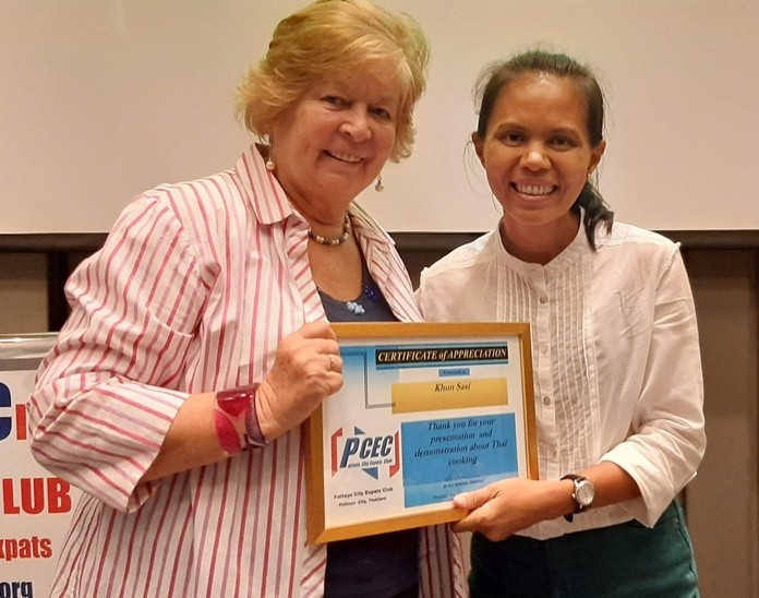 MC Pat Glynn presents Sasi with the PCEC's Certificate of Appreciation for her interesting and informative talk about and demonstration of Thai cooking.