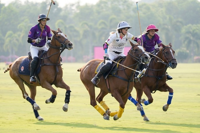 The polo match in action, between the La Familia Team (white) and Marengo Team (purple).