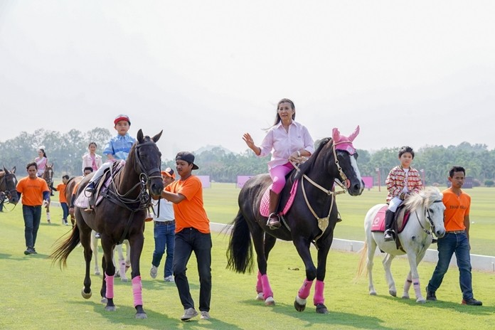 Nuntinee Tanner, Thailand's first polo player and head of the tournament organizing team, gracefully leads riders onto the pitch, followed by a parade of Thailand's top celebrities.