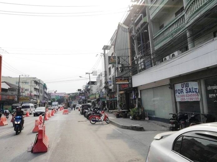 """With the city's main sources of tourists dried up, """"for sale"""" signs are becoming as common as happy hour placards in Pattaya."""