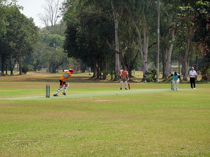Venky drives a ball from Patong CC.