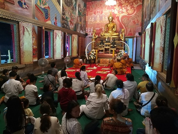Congregations listen to sermons from the most revered monk at Wat Boonsamphan on Soi Khao Noy.