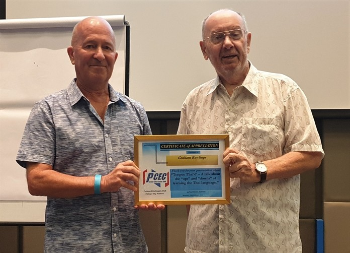 MC Brian Maxey presents the PCEC's Certificate of Appreciation to Graham Rawlings for his informative and interesting take on a good way to learn the Thai language.