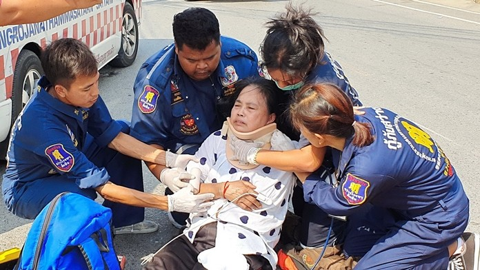 Rescue workers tend to Junong Boonchom before she was transported to Sattahip Km. 10 Hospital.