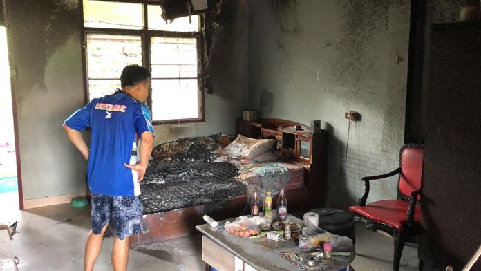 Pattaya firefighters rescued a woman locked by her partner in her burning apartment on Soi Nongyai 8.