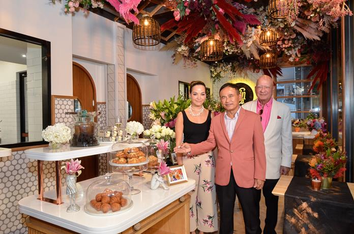 Yanin (left) with papa Dr. Sunya are all smiles as Gen. Paiboon Khumchaya points to delicacies on display in Nin & Co Patisserie.