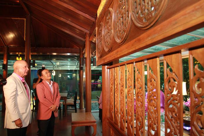 Gen. Paiboon Khumchaya admires the intricate hand-carved teak wood decor in one of the pavilions.