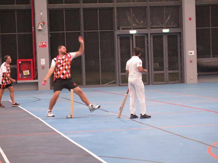 Bernie Lamprecht bowls for PCC on 24 Feb at Rugby School Thailand during the last Pattaya Indoor Cricket League match for the foreseeable future.
