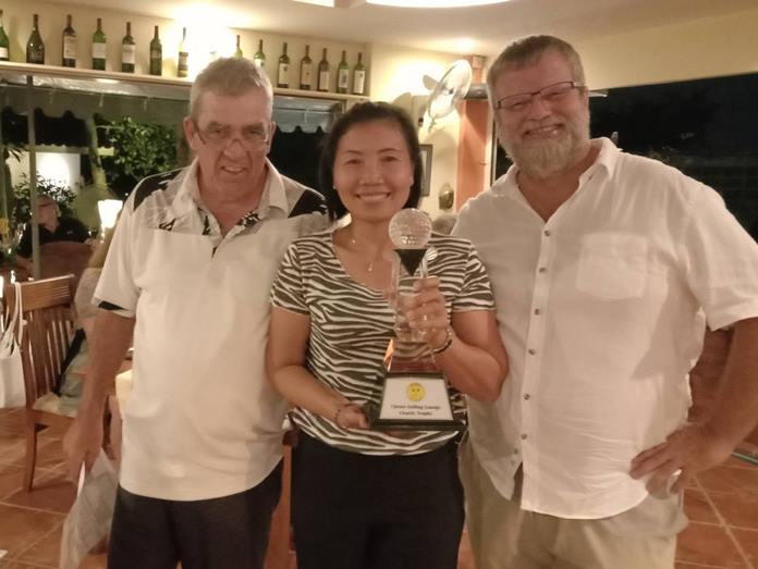 Tournament winner Chanhan Kwanthong hoists the Chrusi's Golfing Lounge Charity Golf Tournament trophy. The annual event raised over 100,000 baht for Jesters Care For Kids, making this the 3rd straight time.