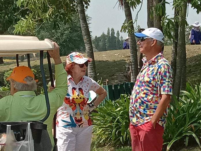 Regina Maeder and Paul Imhof discuss strategy for the next hole.