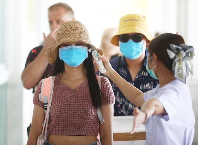 City health workers performed temperature checks on boat passengers and distributed sanitizing hand gel.