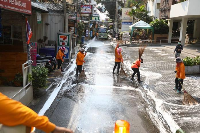 Pattaya health workers sprayed disinfectant on Soi 8 and at Pattaya Police Station to prevent spread of the coronavirus.