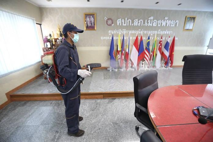 Pattaya health workers sprayed disinfectant in all the rooms of the Pattaya Police Station.