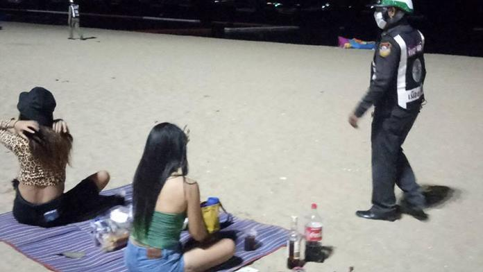 Pattaya police began shooing people off of the beach after Chonburi officials imposed a night-time beach curfew.