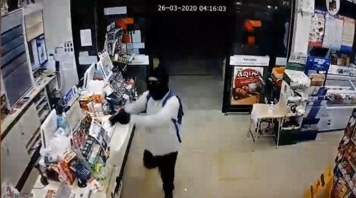 Security cameras captured the man in his 30s robbing the 7-Eleven store on Soi Land Transport Department around 4:30 a.m. March 26.
