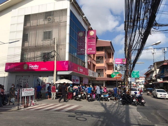 Displaced workers swarm Pattaya banks to register for government unemployment benefits.