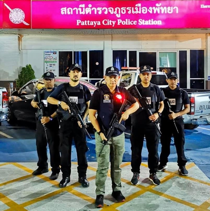 """Pol. Col. Khemmarin Pissamai (center) vowed that, despite the risks of officers contracting Covid-19, they would be on the streets to keep order amid during what he called a """"risky"""" time."""