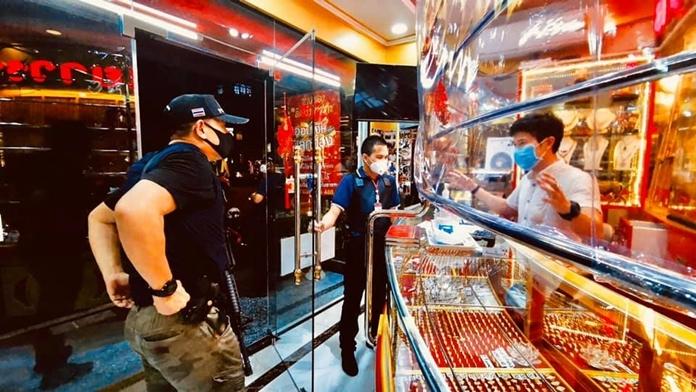 Pattaya police inspect a gold shop.