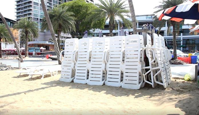Unused beach chairs are stacked away as there are not enough tourists to rent them to.