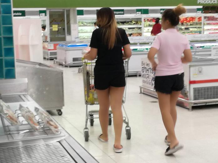 Panic shoppers race through a local supermarket buying as much as they could because shelves were emptying very fast.