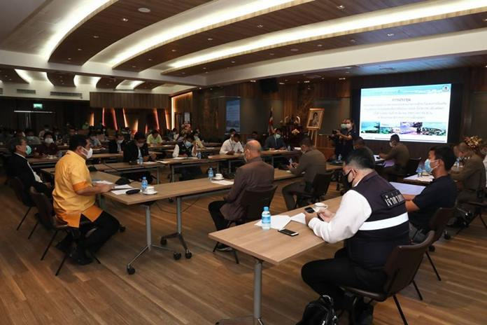 Pattaya City counselors wearing face masks distance themselves from each other during the meeting.