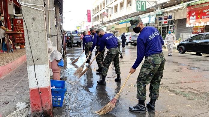 The volunteers rode hosed down streets in Sattahip communities.