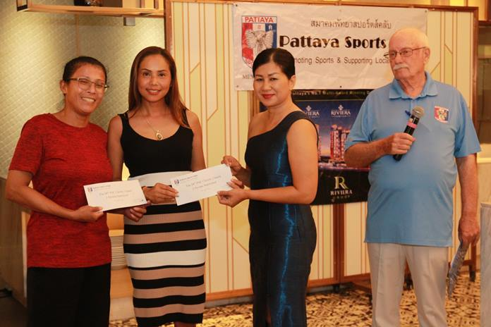 Fifth was one of 4 all girl teams, Nichawan Khiaophuang & Phonruang Banyen accept their prize from Noi, PSC Charity Chair.