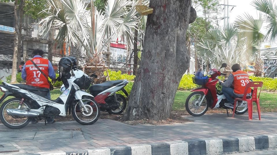 Motorbike taxis sit idle as fares are few and far between.