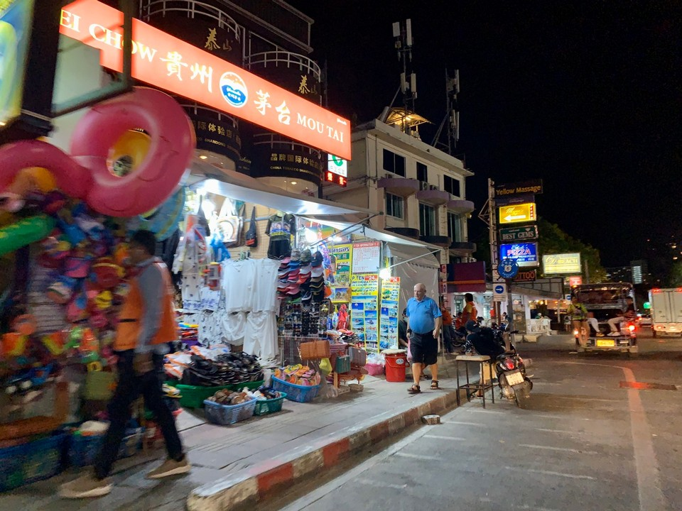 A souvenir shop is the brightest spot on Beach Road in the midst of closed bars and nightlife venues.