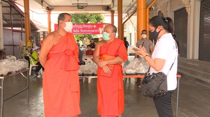 Bangkok's Wat Arun temple on the bank of the Chao Phraya River offers food to those affected by businesses closures and the virus control measures.