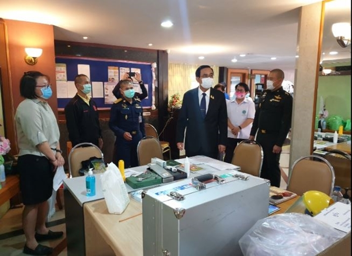Thai PM walks around the hotel in Bangkok that has been turned into a state quarantine facility for Thai returnees from overseas.