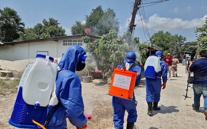 The teams wearing protective suits and backpacks of disinfectant on their mission to clean the Thai villages.