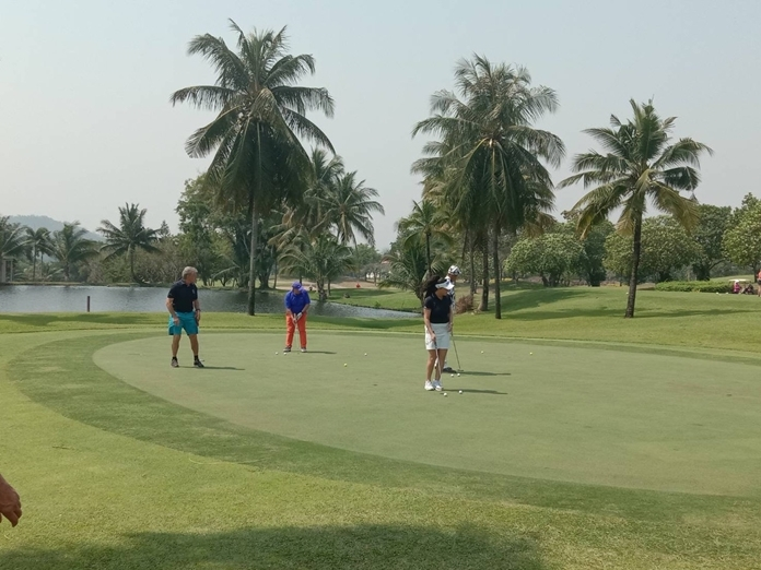 Smart golfers get ready on the putting green.