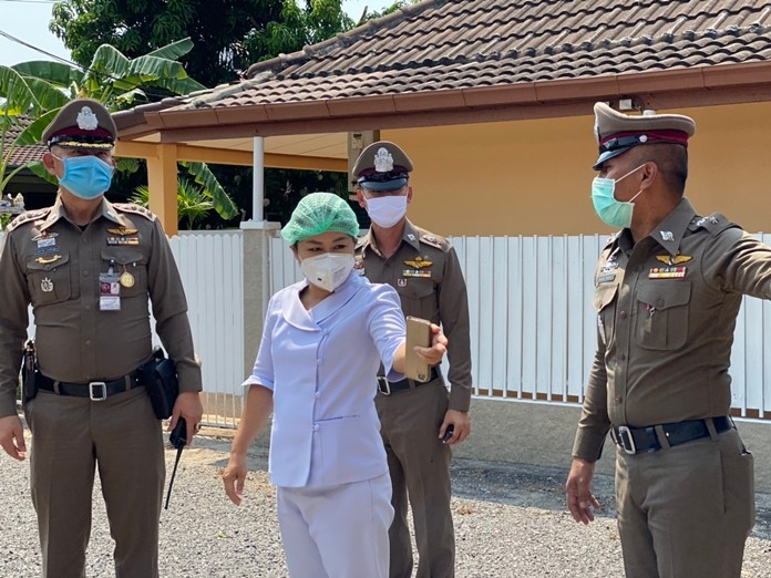 """Nurse Pawida Kursuwannawong, who works at a Pattaya Hospital to screen potential Covid-19 cases, was among the first to sign up for the """"Keep Fighting, We'll Watch Your House"""" program."""