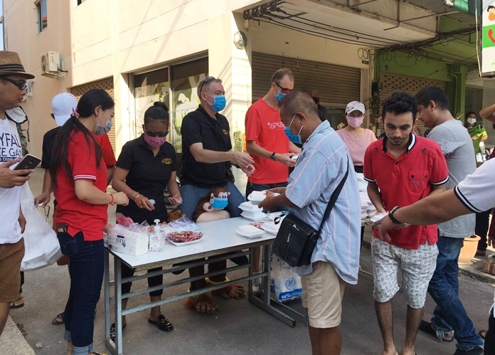 Supattra Chonlapol and Brad Rogers, owners of Skyfall a-Go-Go and JP Republic, along with friends passed out free meals at the Flybird Market March 30.