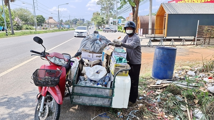 Nikorn drives and walks along the Huay Yai Road looking for and picking up as much 'treasure' as he possibly can.