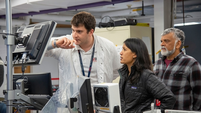 (Left to right) Mars Helicopter assembly, test, launch operations interface lead Teddy Tzanetos, project manager MiMi Aung and chief engineer Bob Balaram observe a flight test on Jan. 18, 2019, as the flight model of the Mars Helicopter was tested in the 25-foot-wide vacuum chamber at JPL. (Credits: NASA/JPL-Caltech)