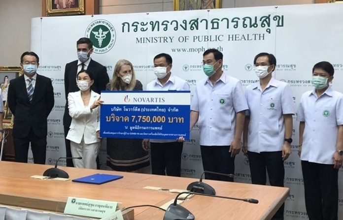 Public Health Minister Anutin Charnvirakul receives donations of 7.75 million baht from drug manufacturers in Switzerland to support the treatment of COVID-19 patients and protect medical personnel.