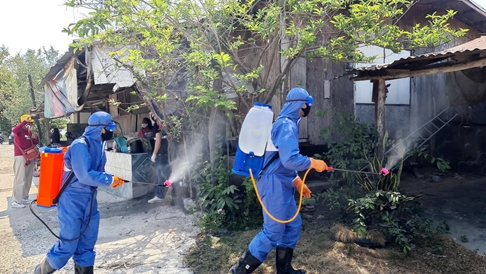 The Covid Killers on the march spraying disinfectant in the Plutaluang community.