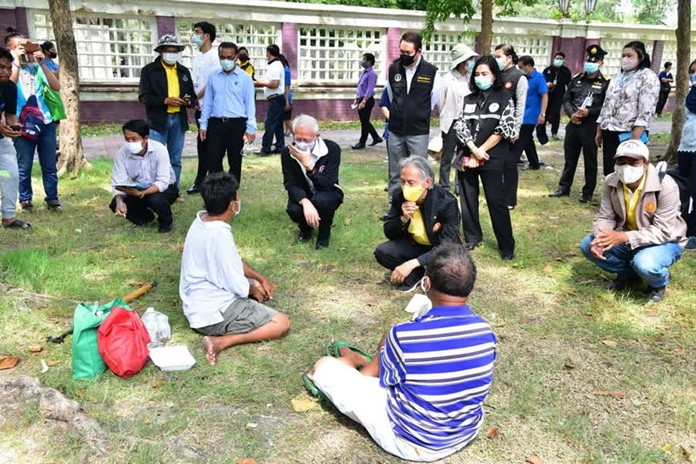 Thai social development agencies talk to a group of people seeking help from the government.