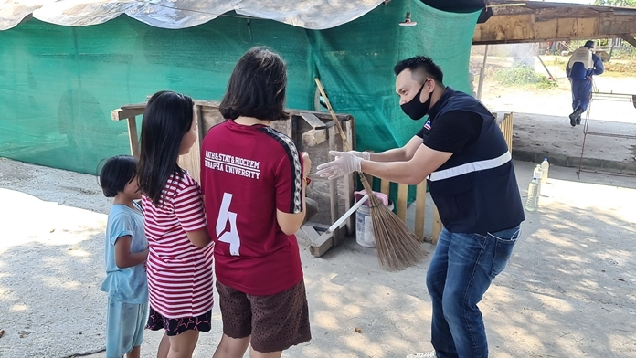 Dr. Satira Puakpraphan speaks to children in the village and instructs them to wash their hands often.