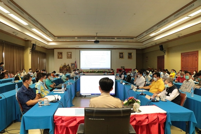 Chonburi Gov. Pakarathorn Thienchai chairs a provincial meeting with district chiefs, mayors, public health officials, village heads, Kamnans and security head staff to lay out details for a curfew and a long list of restrictions.